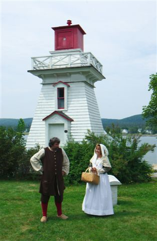 Courtesy Historical Association of Annapolis Royal Actors in historical costumes in front of the Annapolis Royal Lighthouse.