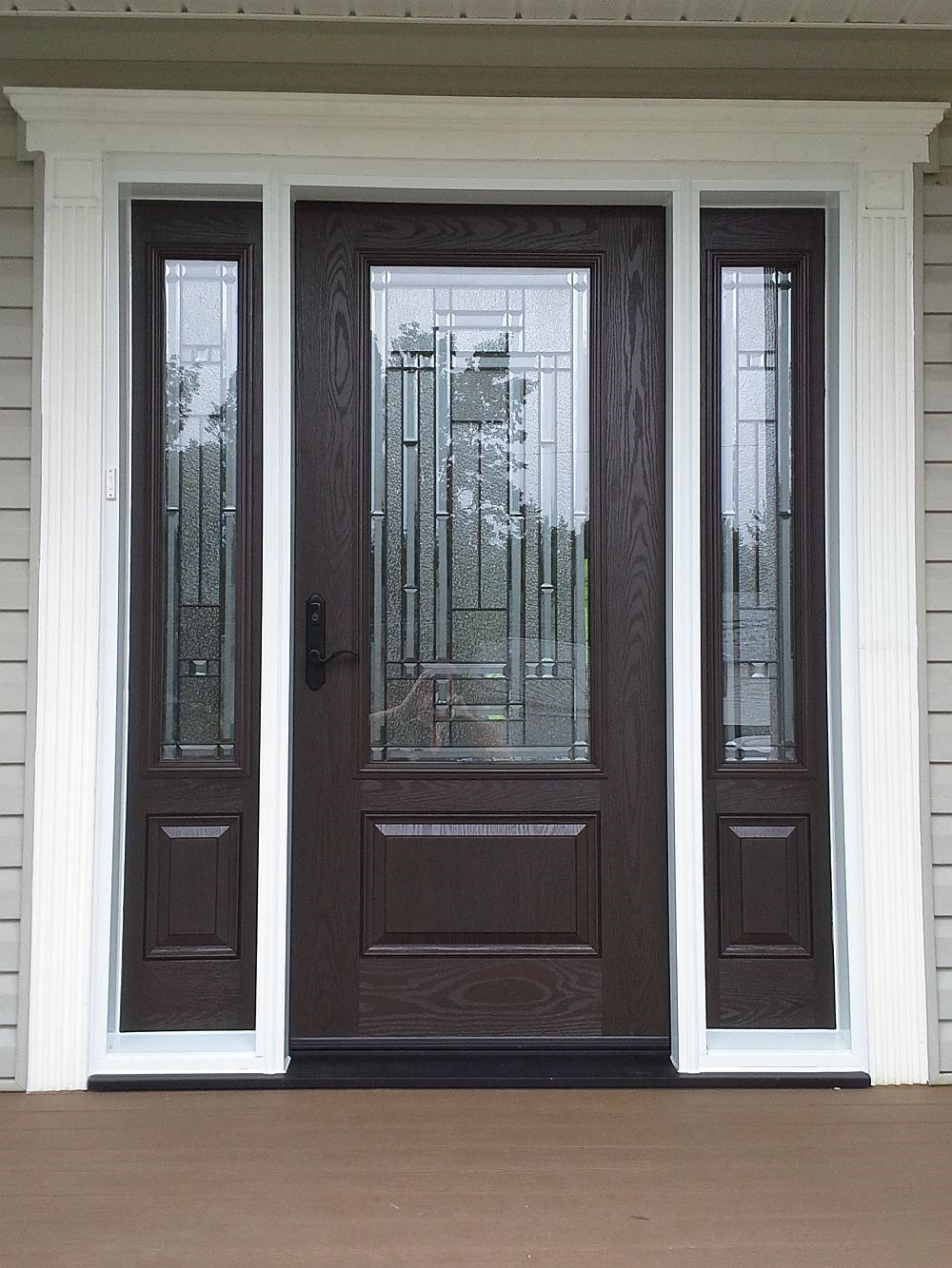 A classic brown fibreglass door installed by Windows Plus.