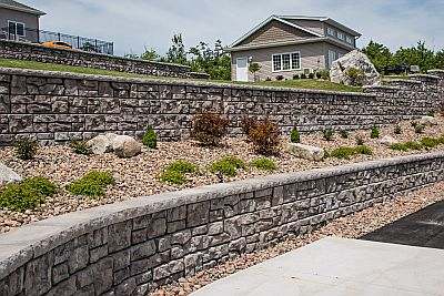 Natural stone walls are functional, but can also enhance your property visually.